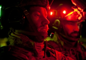 Joel Edgerton (left) leads SEAL Team 6 in the climax of 'Zero Dark Thirty'.