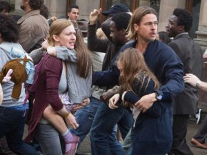 Brad Pitt and Mireille Enos struggle to escape a tepid movie in 'World War Z'.