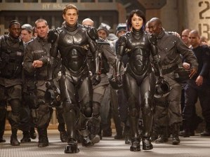 Charlie Hunnam and Rinko Kikuchi battle to save the earth -- and summertime cinema -- in 'Pacific Rim'.